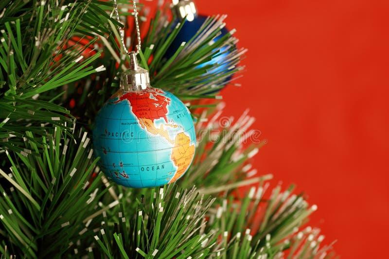 Globe as christmas ornament stock image