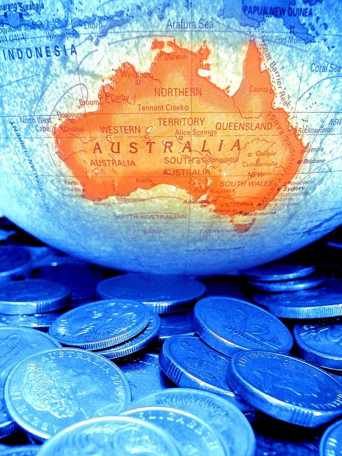 Globe Coins Australian Money Budget. Globe with orange Australian continent and blue toned money royalty free stock photos