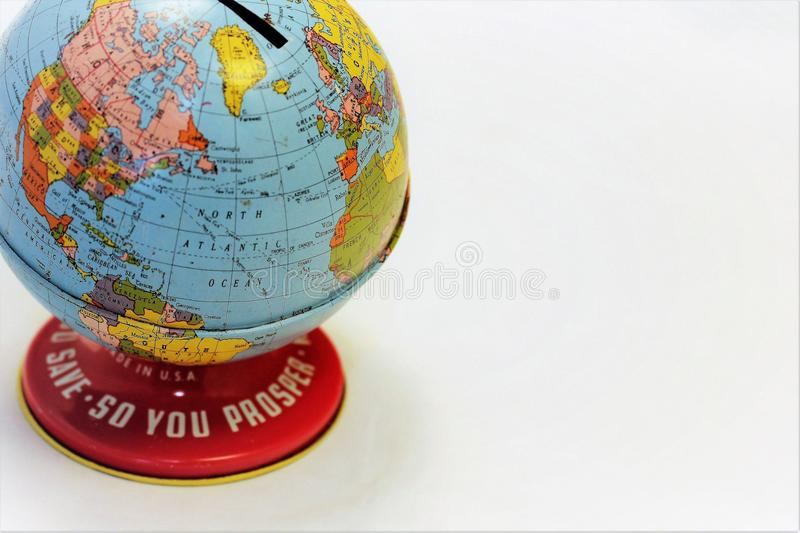 Globe bank to save money or coins piggybank. This is a colorful World`s Fair globe bank with the saying, `Save So You Prosper`. Closer shot stock photography