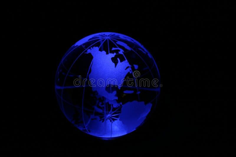 Globe in blue light stock images