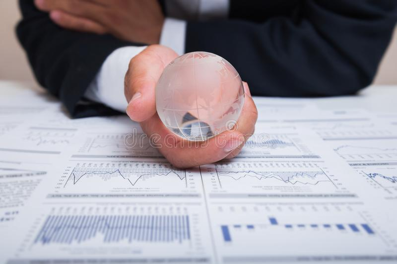 Globe with chart papers royalty free stock photo