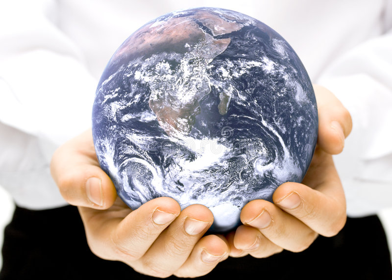 The globe in children's hands stock images
