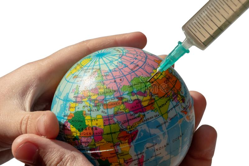 Globe in children`s hands. A syringe is plugged into Kazakhstan. Isolated. The concept of global disease and treatment of the. A syringe is plugged into royalty free stock images