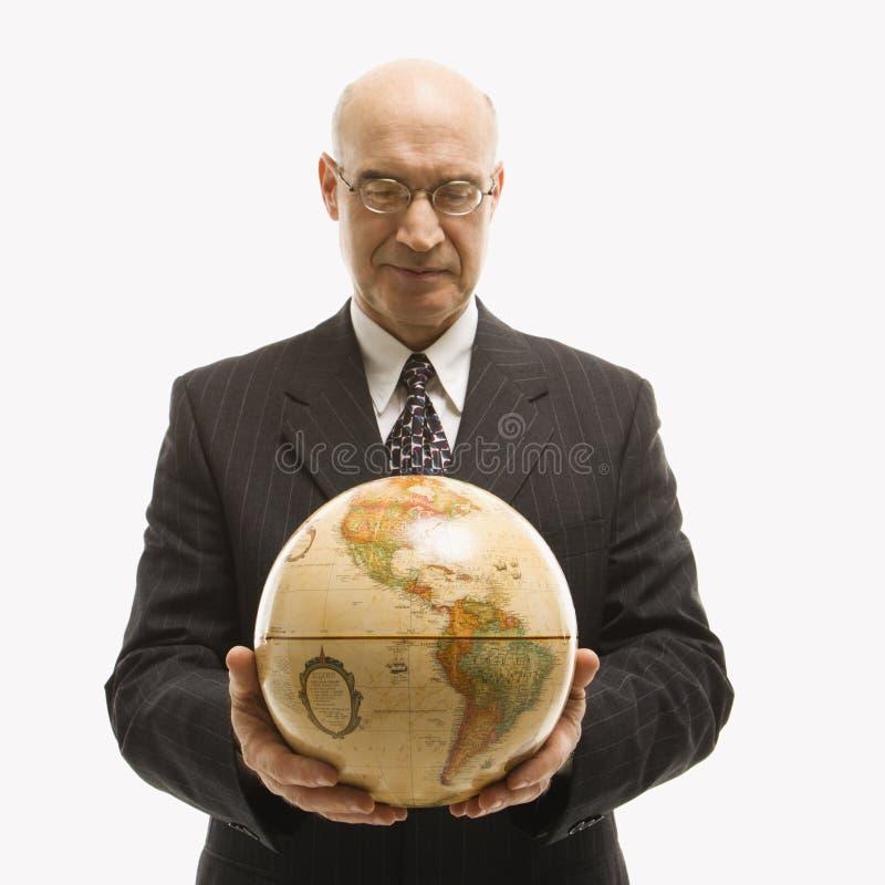 Globe de fixation d'homme d'affaires. image libre de droits