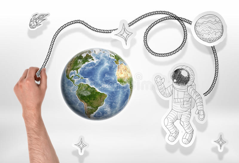 Globe and drawn astronaut, rockets, comets, stars. Globe and cosmos. Cosmology and Astronomy. Study of the Universe. Manned space flight. Elements of this stock photo