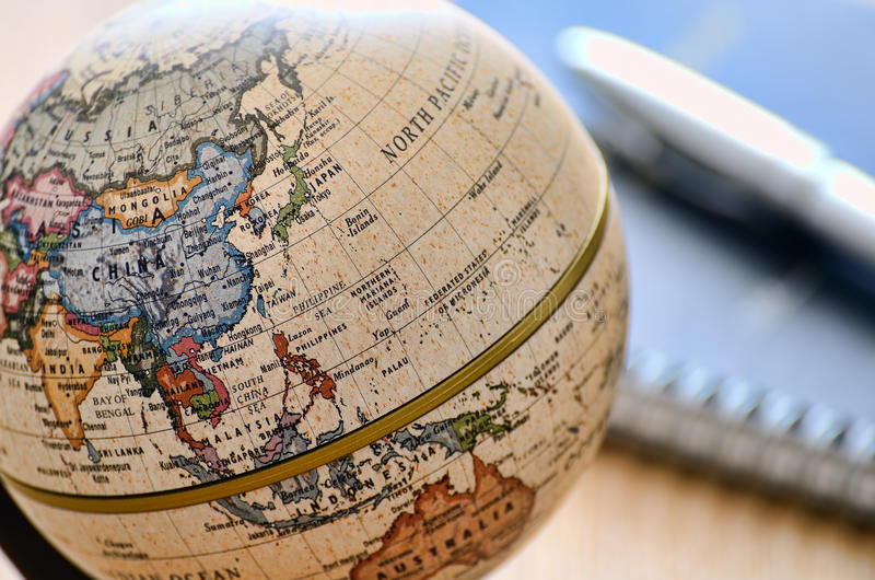 Globe East Asia(ballpoint pen and notebook) royalty free stock photos