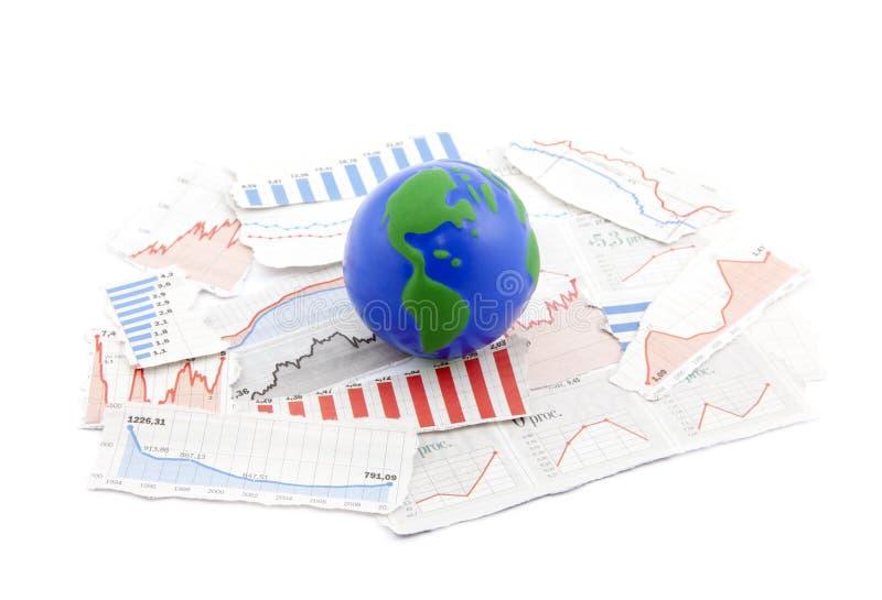 Globe on financial charts stock photography