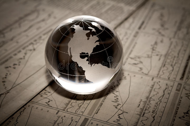 Globe with financial papers royalty free stock photo
