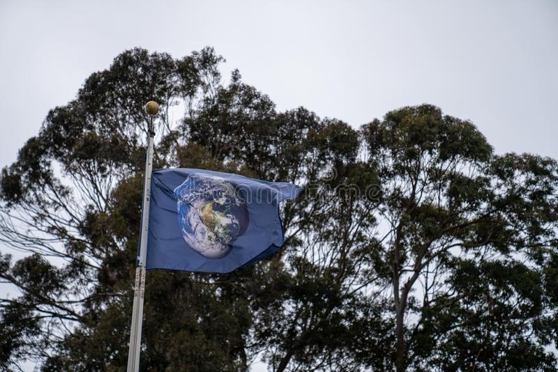 Globe flag waving outside of Internet Archive headquarters. San Francisco, CA MAY 19, 2019: Globe flag waving outside of Internet Archive headquarters royalty free stock images