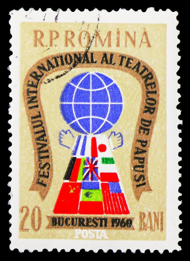Globe and Flags, Stylized Puppet, International Puppet Theatre Festival Bucharest serie, circa 1960. MOSCOW, RUSSIA - FEBRUARY 9, 2019: A stamp printed in royalty free stock photos