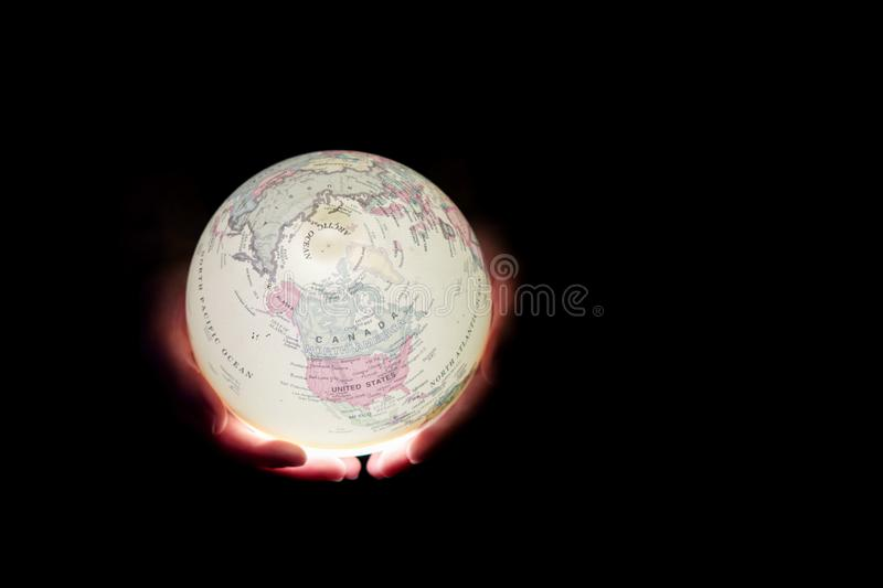 Globe glow in hands. Earth Day stock photo