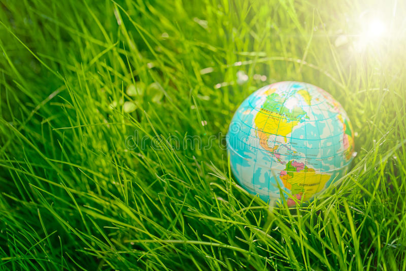Globe on grass. earth day, environment concept royalty free stock photography