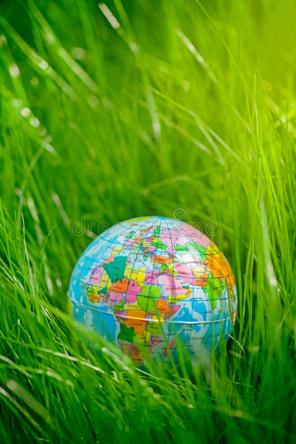 Globe on grass. earth day, environment concept stock photography