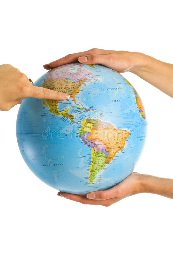 Globe in hands stock images