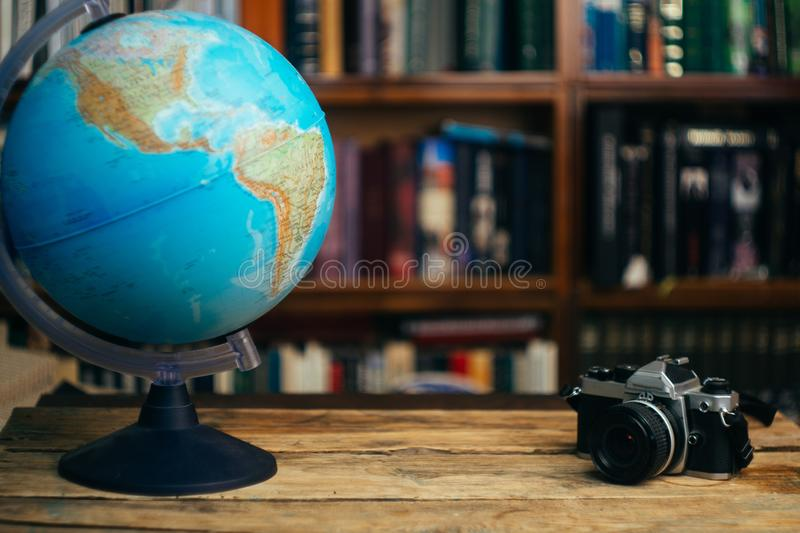 The globe in the library school, university, college on the table. Travel, learning and study concept. Copy space royalty free stock photos