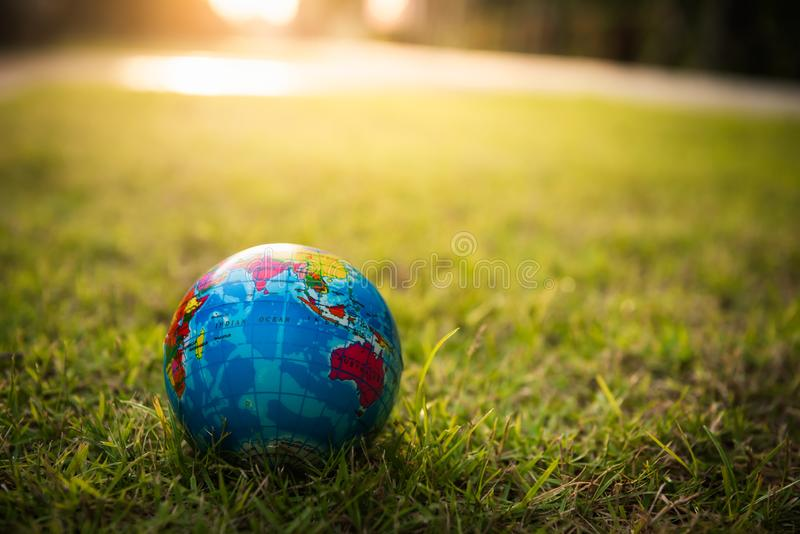The globe is lying on the grass, Safe the earth concept stock photo