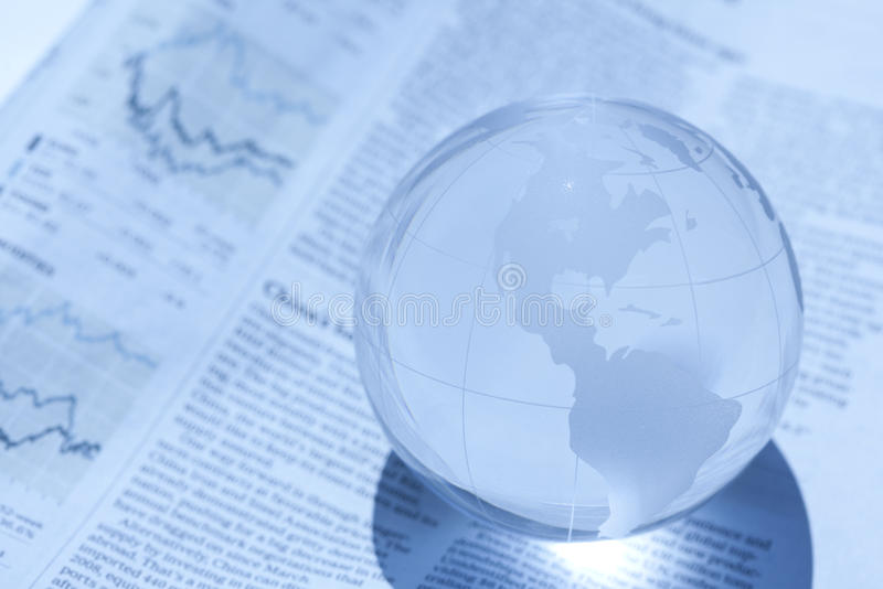 Globe and newspaper stock photo