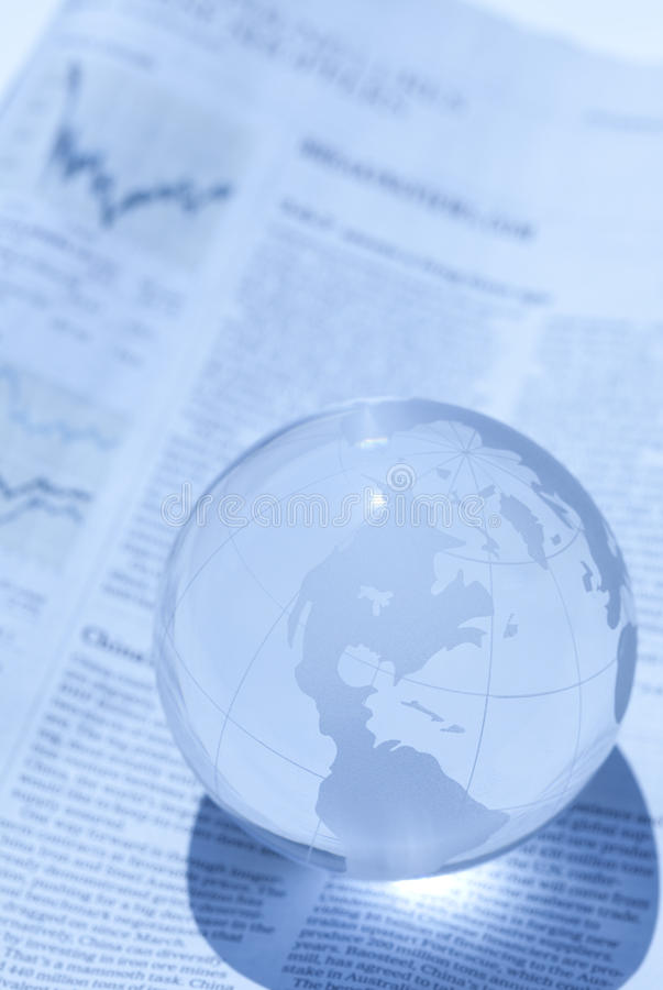 Globe and newspaper stock images