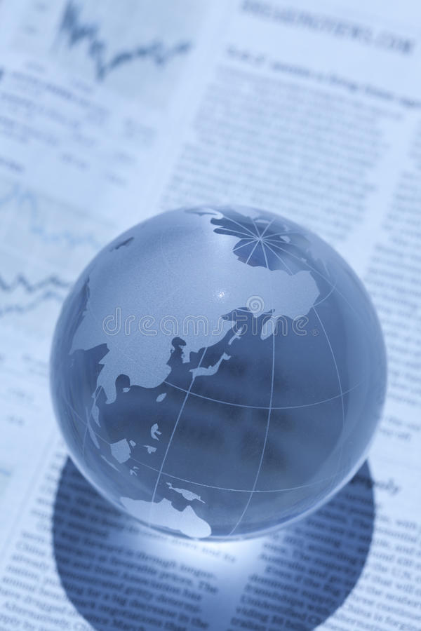 Globe and newspaper royalty free stock photos