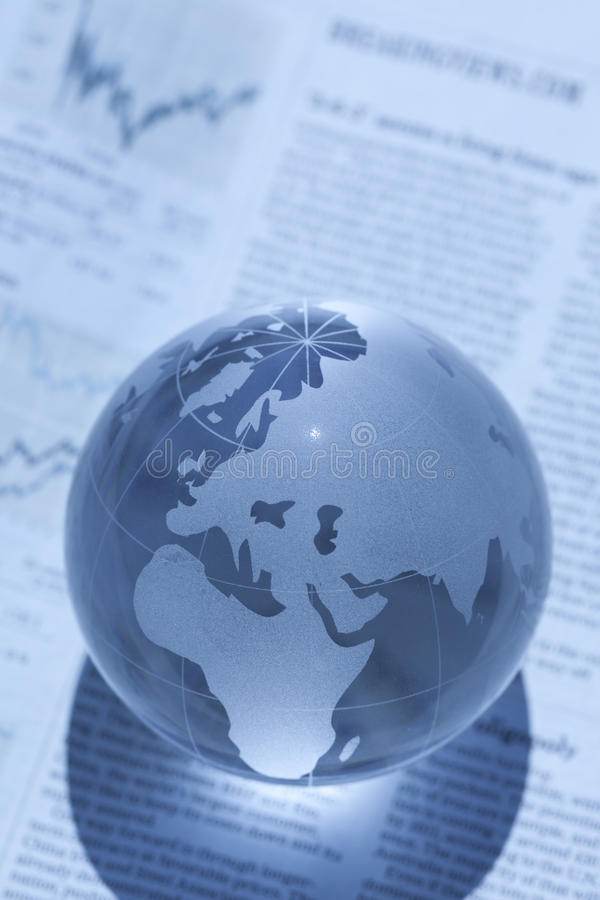 Globe and newspaper stock image