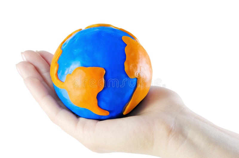 Globe in the palm stock photography