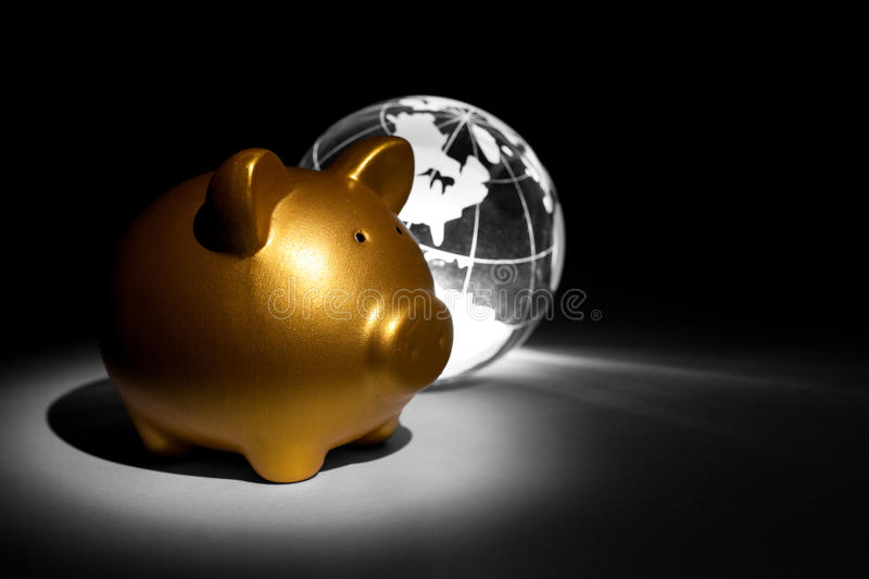 Globe and Piggy bank. For background royalty free stock photography