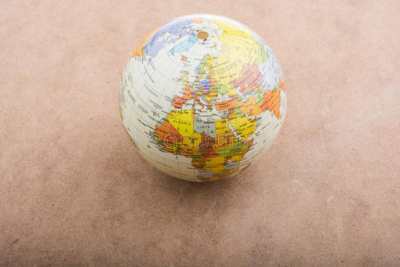 Globe placed on brown background stock photography
