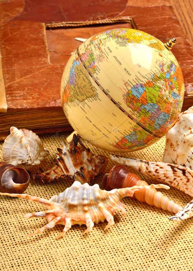 Globe, seashells, old album. Globe, seashells and old album royalty free stock photos