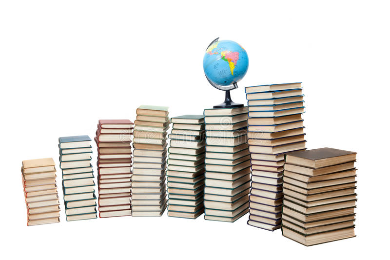 A globe on stacks of old books royalty free stock photo