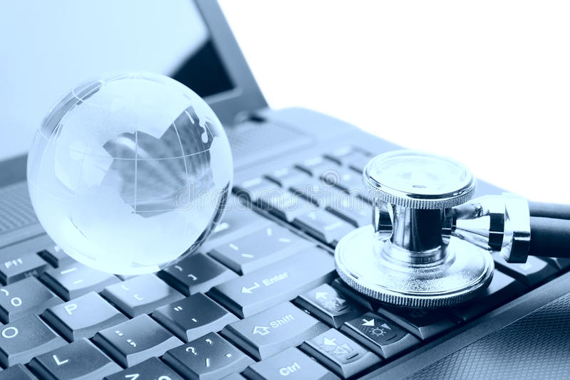 Globe and Stethoscope on a laptop keyboard royalty free stock photo