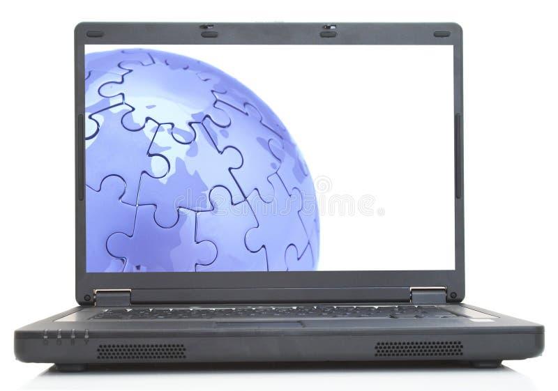 Globe sur l'ordinateur portatif photo libre de droits