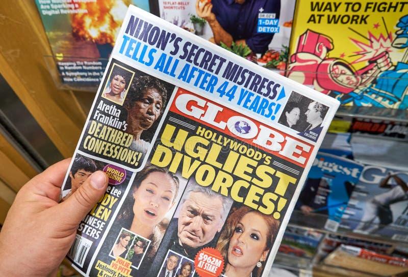 Globe tabloid in a hand. MIAMI, USA - AUGUST 22, 2018: Globe tabloid in a hand. Globe is a supermarket tabloid royalty free stock photos