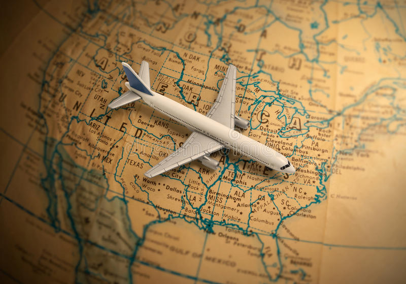 Globe with toy jet airliner stock image