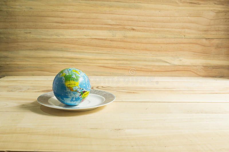 Globe toy placed on the plate. stock images