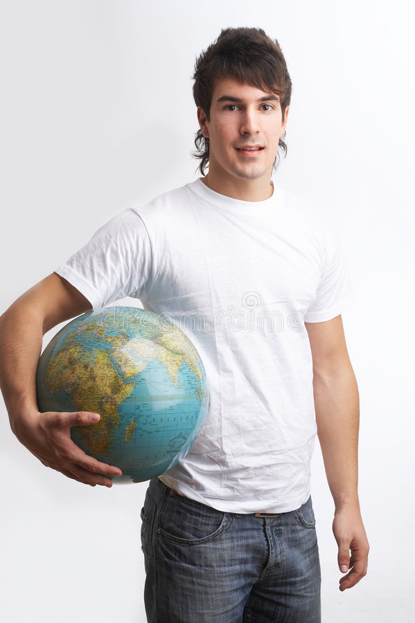 Globe under his arm. One young man with a white shirt is holding a globe royalty free stock photos