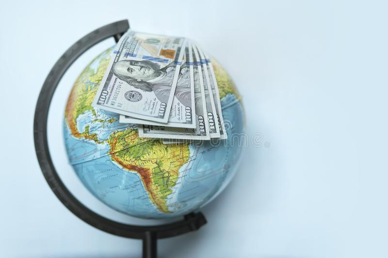 Globe on US dollars. On a blue background. Symbol world currency and globalization. The world's money. Money for travel. 500 dollars stock photos