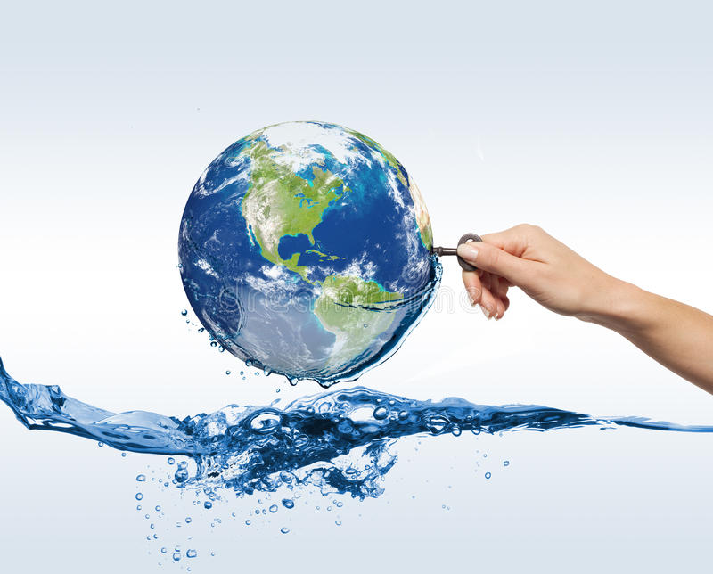Globe with water and hand with the key. Globe with water, hand with the key stock images