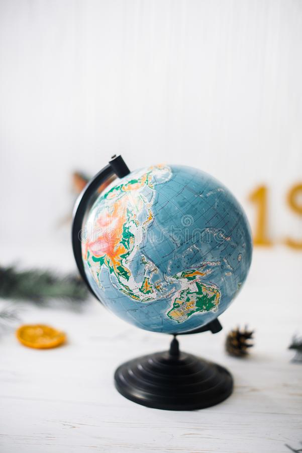 Globe on white wooden blurred. Travel concept.  stock image