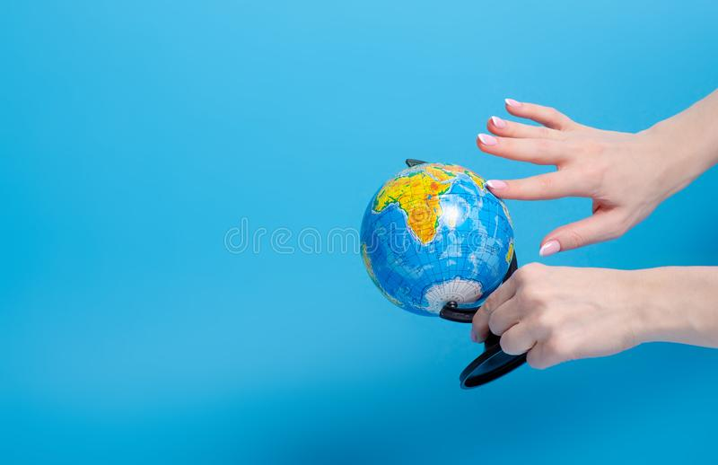 Globe world in hand. On blue background royalty free stock photos