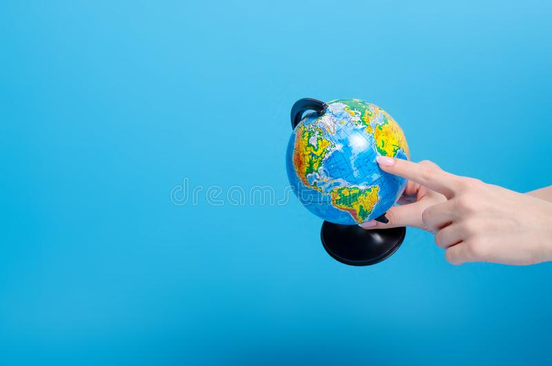 Globe world in hand. On blue background stock image