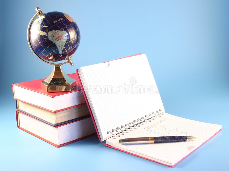 The globe and a writing-book royalty free stock photos