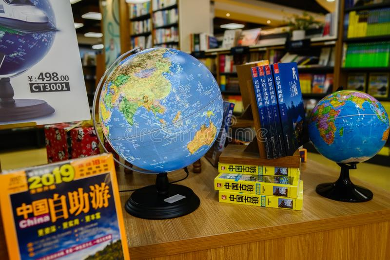 Globes and travelling books on table in bookstore,China stock photo