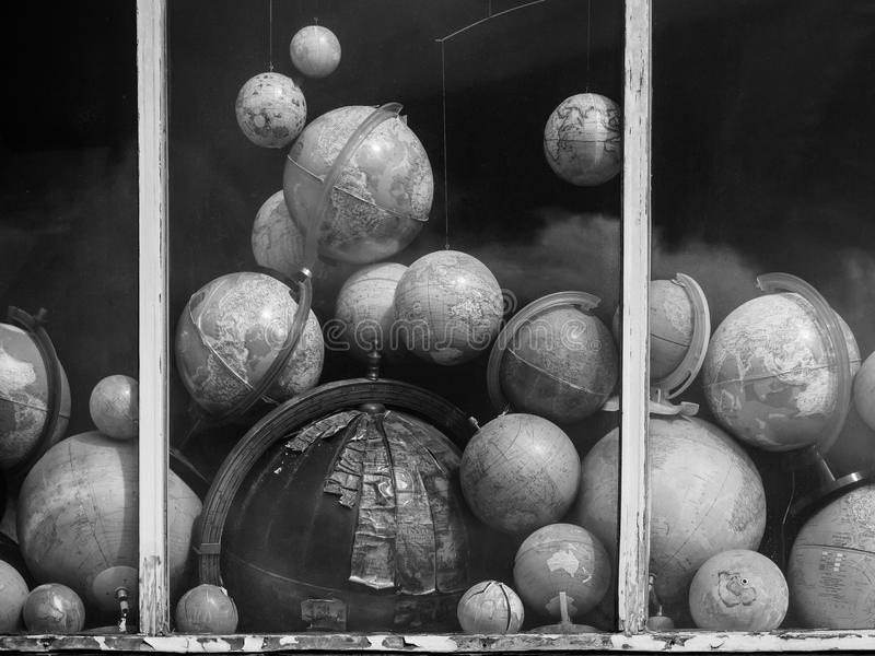 Globes in a window. The globes are lying as if they had collapsed from the outer space in this particular window royalty free stock images