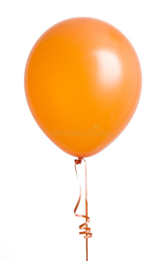 Globo anaranjado en blanco imagen de archivo libre de regalías