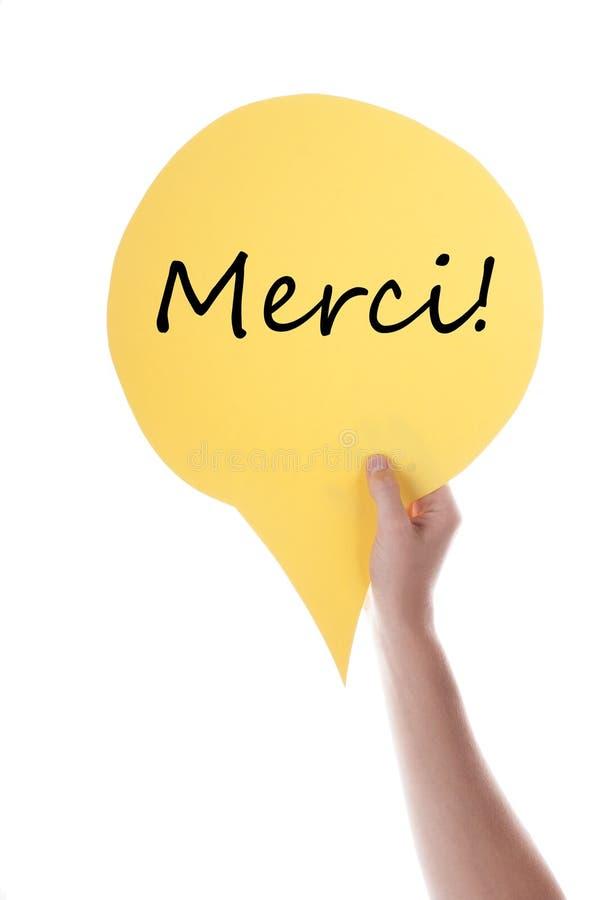 Globo de discurso amarillo con Merci foto de archivo libre de regalías