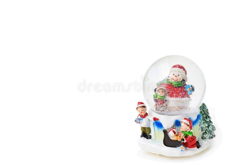 Globo de la nieve de la Navidad aislado en el fondo blanco fotografía de archivo
