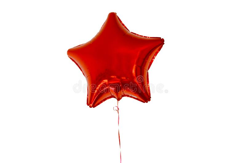 Globo del aire caliente en la forma de una estrella del color rojo en el aislante blanco del fondo foto de archivo libre de regalías