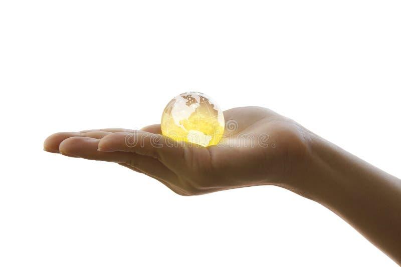 Globo del cristallo della holding della mano immagine stock