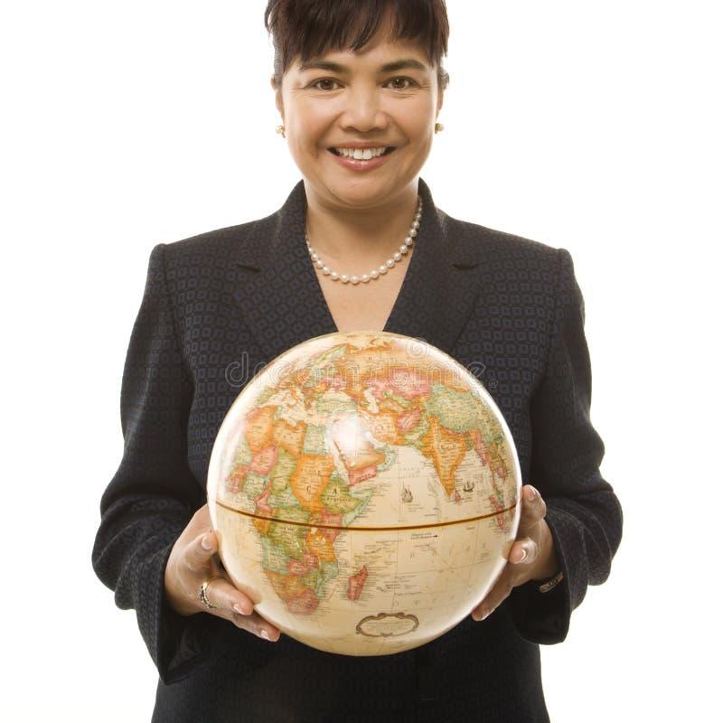 Globo della holding della donna di affari. fotografia stock libera da diritti