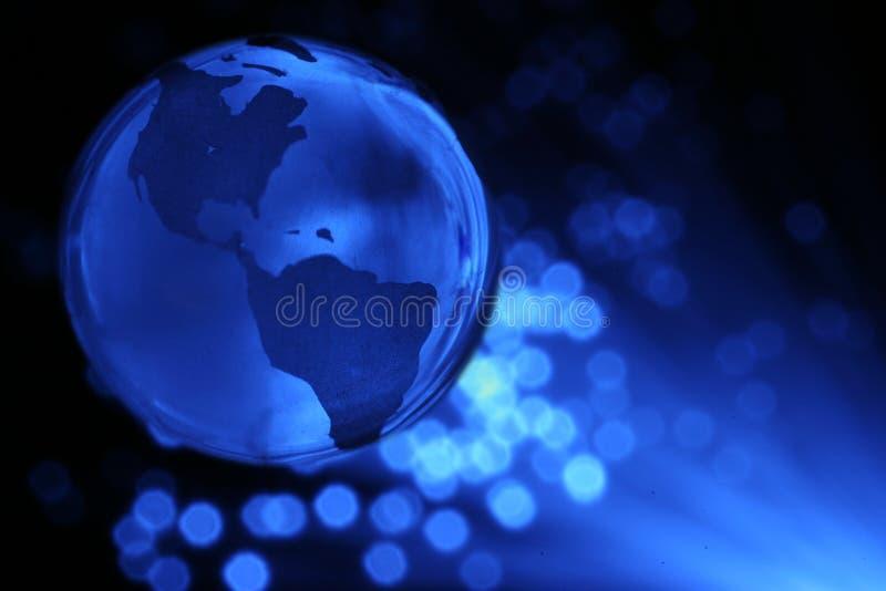 Globo e fibras ópticas da terra imagens de stock royalty free